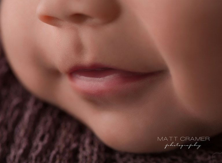 macro shot of baby girl smiling lips and nose