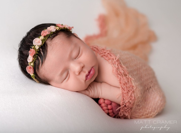 newborn baby girl posed for photoshoot